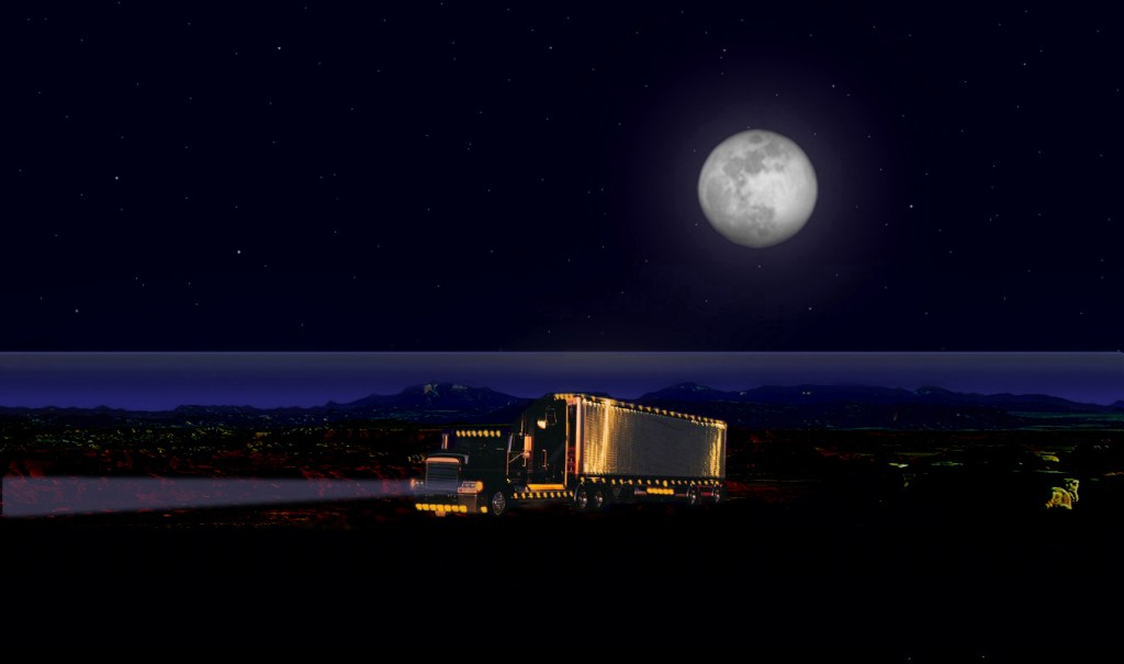 Semi under a full Moon by the sea.